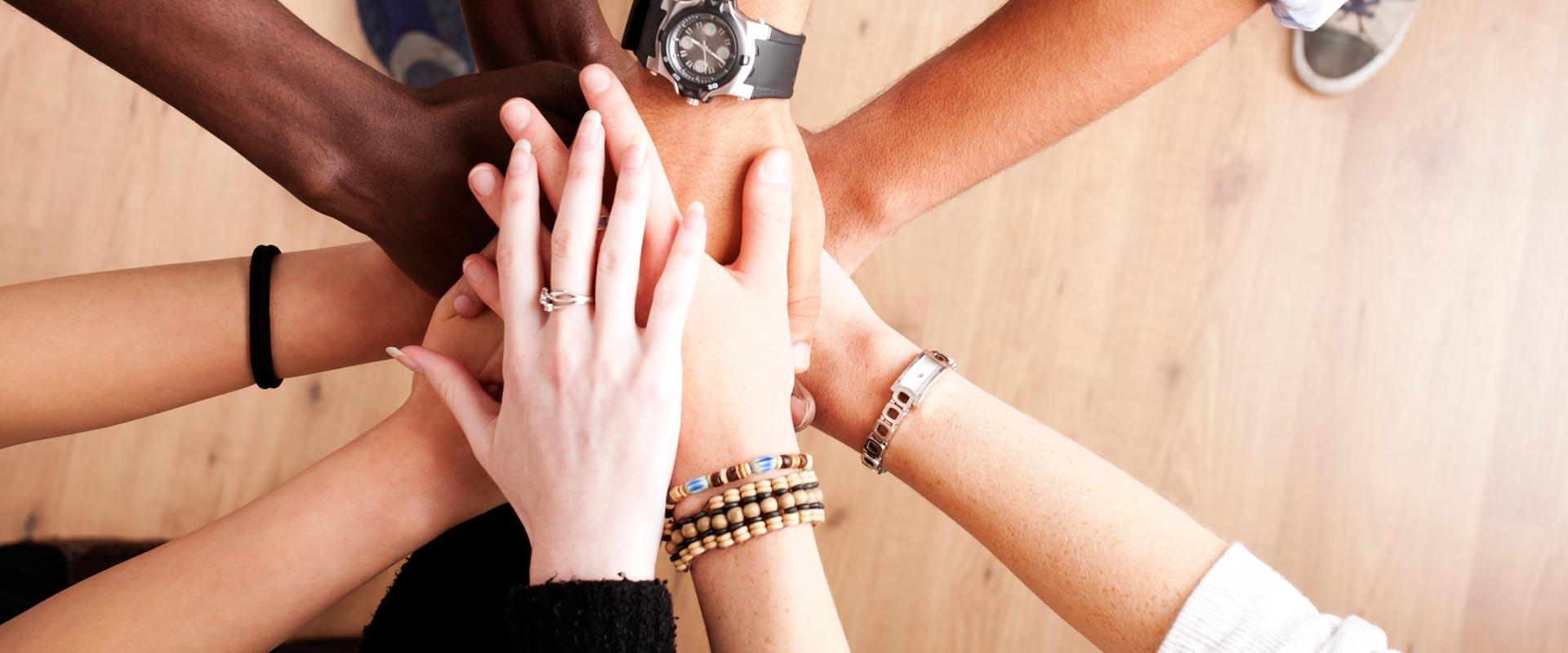 BGC teamwork - hands coming together